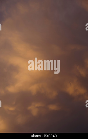 Clouds in sunset sky - Stock Image