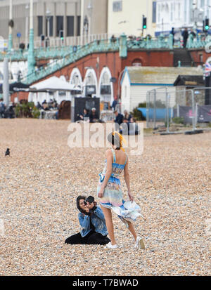 Brighton UK 6th May 2019 - Time for a photograph despite the chilly weather on Brighton Beach as they enjoy the May Bank Holiday with unsettled cool conditions forecast to continue throughout Britain over the next few days. Credit: Simon Dack / Alamy Live News - Stock Image
