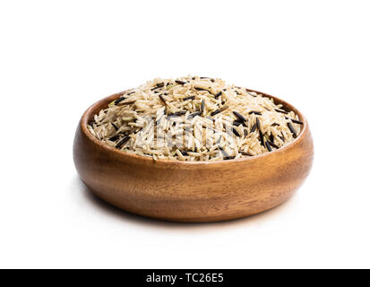 Wild  brown basmati rice in a wooden bowl isolated on white - Stock Image