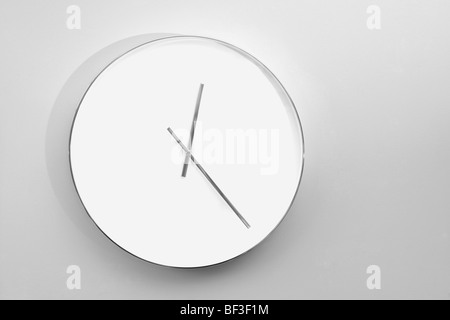 Close-up of a clock hanging on the wall - Stock Image
