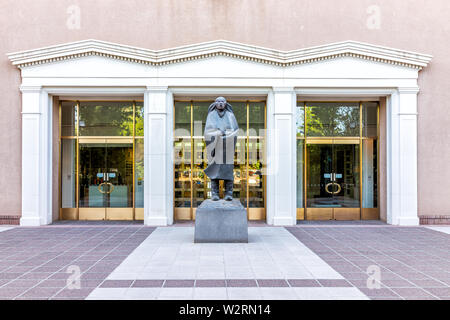 Santa Fe, USA - June 14, 2019: Capitol building in downtown center of city with statue by entrance - Stock Image