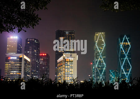 High-rise buildings in Futian Central Business District (CBD) illuminated at night. Shenzhen, Guangdong Province, China. - Stock Image