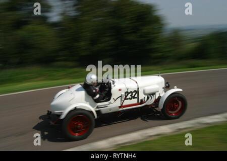 1926/30 Alvis at speed on Prescott Hill climb. - Stock Image