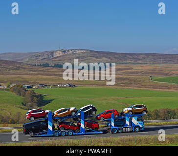 ECM Vehicle Delivery Service Limited Car Tranhsporter. M6 Northbound carriageway, Shap, Cumbria, England, United Kingdom, Europe. - Stock Image