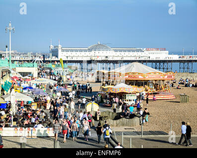 Spring crowds gathering to enjoy the unseasonably hot weather: Brighton Beach, East Sussex, England - Stock Image