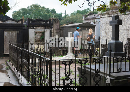 Lafayette Cemetery New Orleans, view of tourists visiting Lafayette Cemetery No.1 in the Garden District of New Orleans, Louisiana, USA - Stock Image