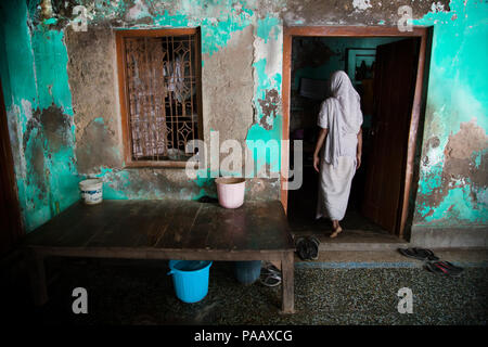 Lonely Indian Hindu widow woman living in an ashram for widows in Vrindavan , India - Stock Image