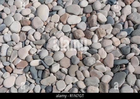 Stones on beach, Aphrodite's Beach (Petra tou Romiou), Kouklia, Pafos District, Republic of Cyprus - Stock Image
