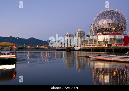 Telus World of Science dome on False Creek in Vancouver, BC, Canada, with Aquabus passenger ferry. Science World Vancouver. - Stock Image