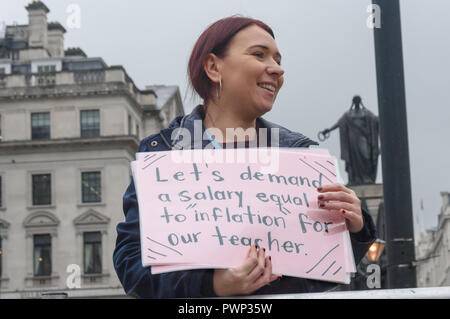 London, UK. 17th October 2018. A woman holds up a poster written by a student unable to be present as staff and students from Further Education Colleges across the country meet in Waterloo Place to march to a rally in Parliament Square calling for the vital work that FE Colleges do to be recognised and properly funded. The #Loveourcolleges action called for funding to allow the colleges to do their job properly and to pay teachers on comparable rates to their colleagues in schools and Higher Education. Credit: Peter Marshall/Alamy Live News - Stock Image