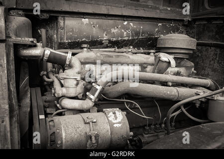 A rusty and dirty old bus engine. - Stock Image