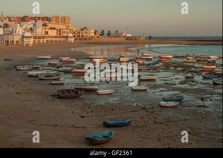 View of the Caleta beach in the Old Town of Cádiz, at sunset. - Stock Image