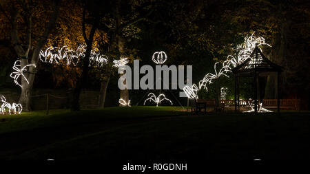Large spider lights at GlasGLOW, where the Botanic Gardens are lit up at night. - Stock Image