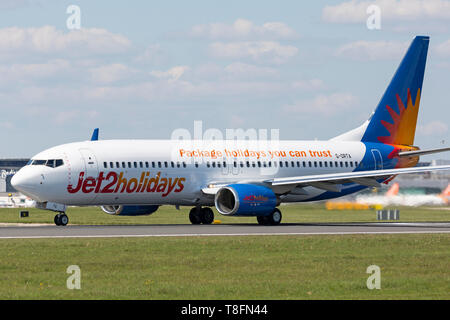 A Jet2 Holiday Boeing 737-800, registration G-DRTA, preparing for take off from Manchester Airport, England. - Stock Image
