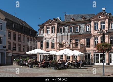 tourists in front of a coffee on the food market in bingen am rhine germany - Stock Image