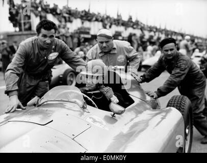 Jul 05, 1955; Silverstone, UK; PETER COLLINS at the wheels of his Ferrari being pushed to the start for the Grand Prix at Silverstone. - Stock Image