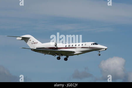 A German registered Cessna 750 Citation X on final approach to Inverness Airport in the Scottish Highlands North - Stock Image