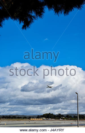 A private jet airplane lifts off from Monterey Regional Airport, Monterey, California, USA. - Stock Image