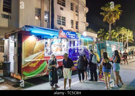 Miami Beach Florida North Shore Beach Ocean Terrace Food Truck & Music Fest monthly event night nightlife street food Hispanic residents man woman - Stock Image