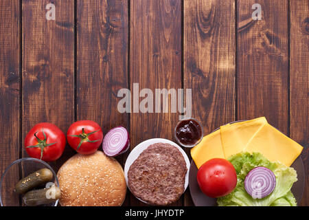 Top view of cheeseburger ingredients - Stock Image