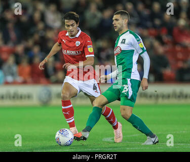 Barnsley, UK. 2nd October  2018, Oakwell, Barnsley, England; Sky Bet League One, Barnsley v Plymouth Argyle ; Stuart O'Keefe (13) of Plymouth Argyle passes the ball as Kenny Dougall (04) of Barnsley pressures    Credit: Mark Cosgrove/News Images  English Football League images are subject to DataCo Licence Credit: News Images /Alamy Live News - Stock Image
