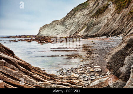 Flysch formations in the geological park at Itzurun Beach, Zumaia, Basque Country, Spain. - Stock Image
