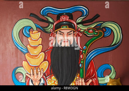 Detail of colourful door paintings inside Kuang Im Chapel, near River Kwai, Kanchanaburi, Thailand. - Stock Image