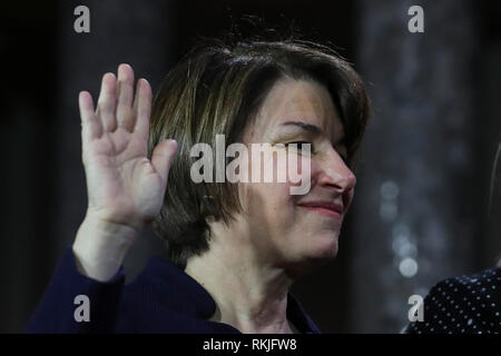 US Senator Amy Klobuchar, Democrat of Minnesota, is sworn in by Vice President Mike Pence on Capitol Hill in Washington, DC on January 3, 2019. - Stock Image