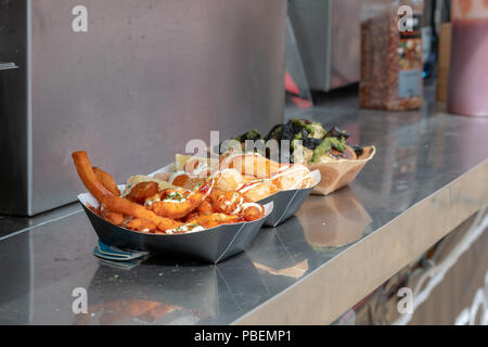 Poole, UK. 28th July 2018. Streetfood options at the Poole Harbour Festival in very windy weather. Credit: Thomas Faull/Alamy Live News - Stock Image