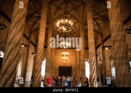 Tourists in the Hall of Columns, Trading Hall, in the Silk Exchange Valencia Spain - Stock Image