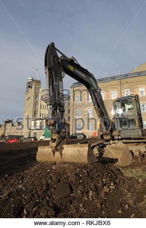 Excavator with Hotel Indigo and Staybridge Suites Dundee Scotland  January 2019 - Stock Image