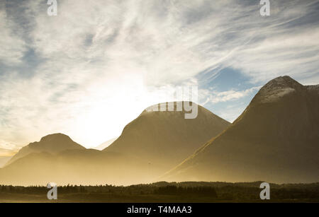 Sunrise over mountains and boreal forest off the coast of Trondheim, Norway. - Stock Image