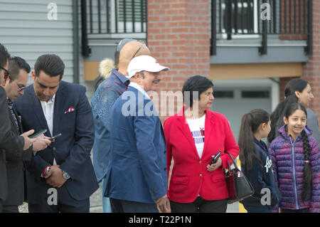 A family of immigrants waiting for Canadian Prime Minster Justin Trudeau.   Maple Ridge, B. C. - Stock Image