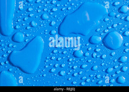 Multiple water drops raindrops on light blue background - Stock Image