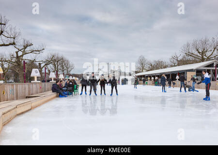 People are skating on the ice rink at the Museumplein in Amsterdam, the Netherlands - Stock Image