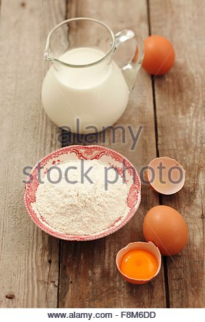 Ingredients for pancakes: flour, eggs and milk - Stock Image