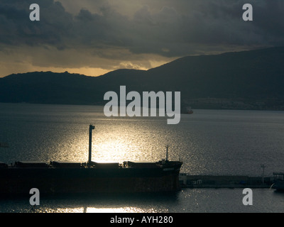 Sunset over The Bay of Gibraltar Shipyard, cloud, freight, ship, shipping, tanker, boat, shipyard, Gibraltarian, Europe, - Stock Image