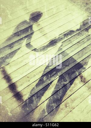 Shadow of a father and son. - Stock Image