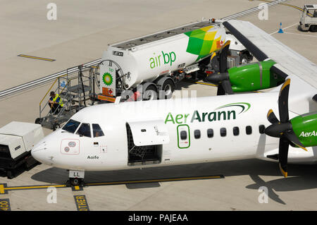 Aer Arann ATR 72-200 parked with Air Bp refuelling bowser behind at London City - Stock Image