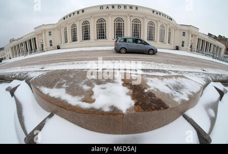 The Winter Gardens, Weston super mare. UK. 2nd March, 2018 A vehicle braves the roads along the sea front after - Stock Image