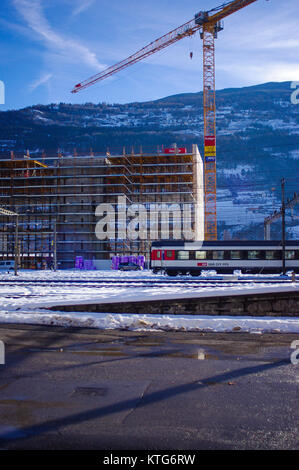 Sion, Switzerland, 23rd Dec 2017.  Construction work takes place behind train station. - Stock Image