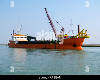 Motor dredger Gino Cucco in the lagoon Venice - Stock Image