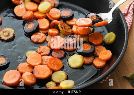 Honey glazed butter fried carrot - Stock Image