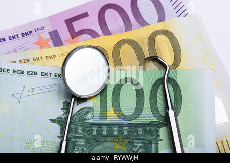 An Overhead View Of Dental Tools On Euro Notes - Stock Image
