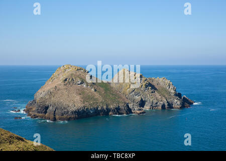 Holywell Bay North Cornwall Gull Rocks on a beautiful day with blue sea and sky - Stock Image