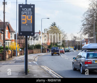 Driving too fast, slow down. A car exceeding the speed limit as it passes a traffic speed warning indicator in Nottinghamshire, England, UK - Stock Image