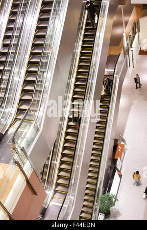 Escalators on different levels viewed from above - Stock Image