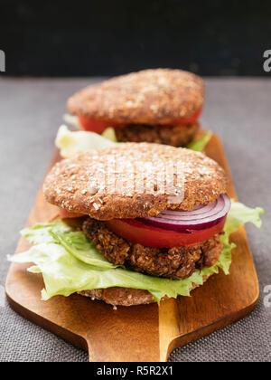 Lentil, Walnut Burgers on Whole Wheat Buns. - Stock Image