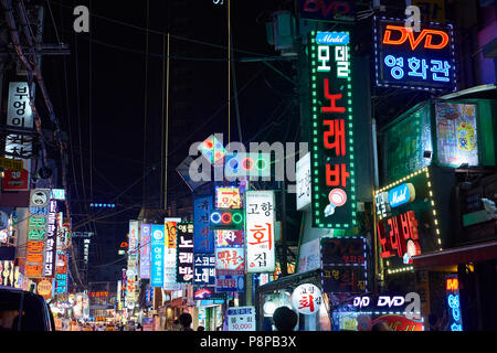 Yeongdeungpodong street at night in Seoul, South Korea, cluttered with shop signs lighting. The area is known for its nightlife. - Stock Image