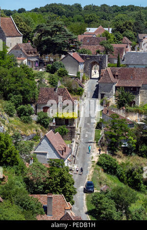 Steep road in Rocamadour in the Lot department in southwestern France. Rocamadour has attracted visitors for its setting in a gorge above a tributary  - Stock Image